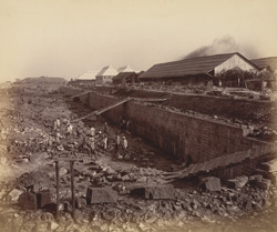 View of south wall looking eastward from S.-W. corner. Mortar mills to the right [Victoria Dock construction, Bombay].